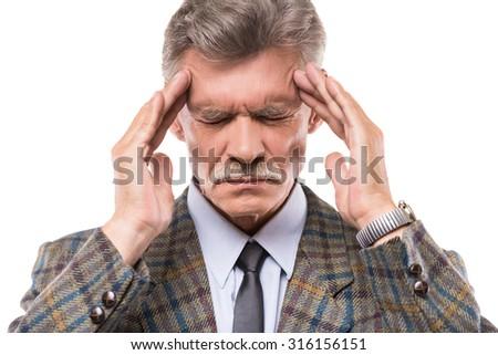 Portrait of senior man is suffering from headache. - stock photo