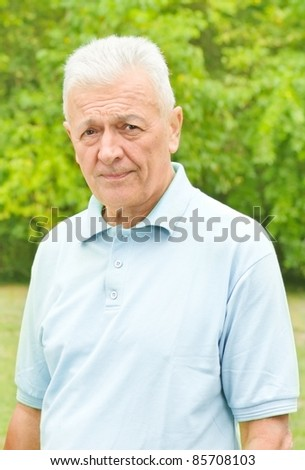 Portrait of senior man outdoors. - stock photo