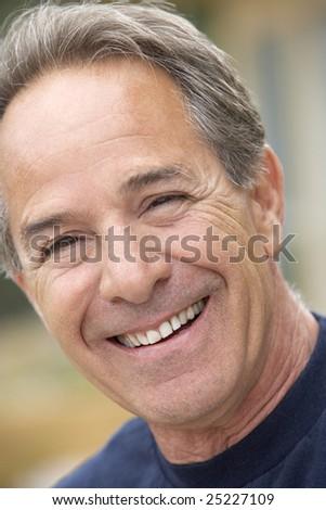 Portrait Of Senior Man Smiling At Camera - stock photo
