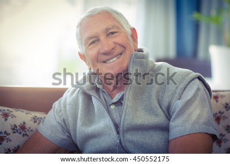 Portrait of senior man smiling at home