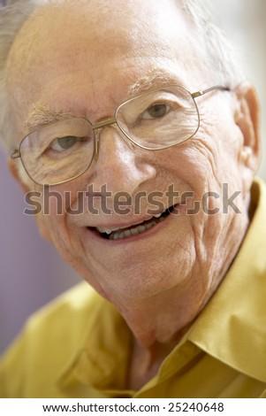 Portrait Of Senior Man Smiling Happily - stock photo