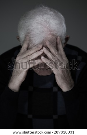 Portrait of senior man suffering from deep depression - stock photo