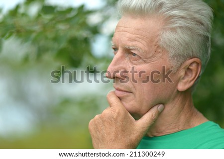 Portrait of senior man thinking about something outddor - stock photo