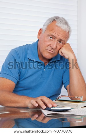 Portrait of senior man upset with financial budget - stock photo