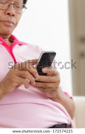 Portrait of Senior man using phone at home