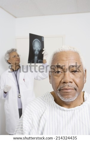 Portrait of senior man waiting for healthcare results - stock photo
