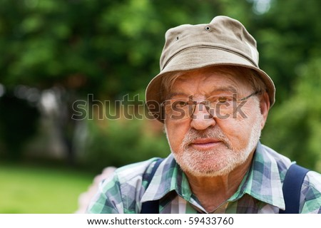 Portrait of senior man wearing cloche hat