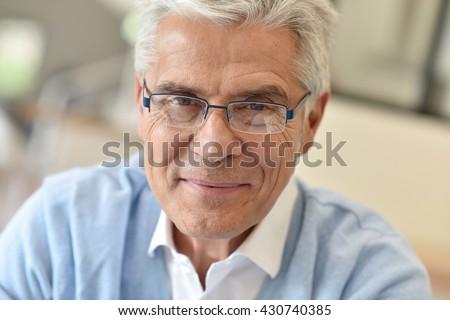 Portrait of senior man with eyeglasses - stock photo