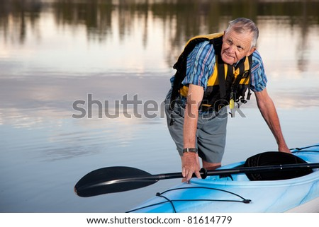 Portrait of Senior Man with Kayak