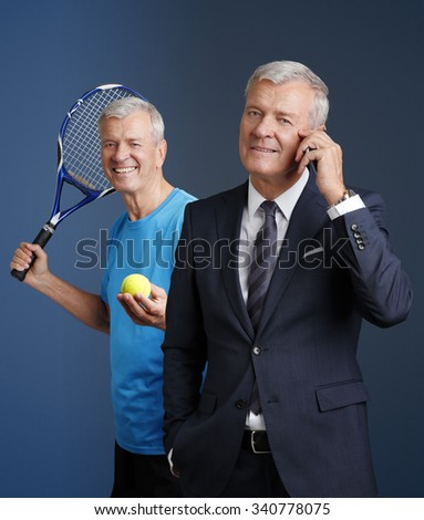 Portrait of senior sporty man and old businessman holding in hands a mobile phone while standing at isolated background.  - stock photo