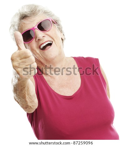 portrait of senior woman approve gesture against a white background - stock photo