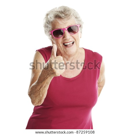 portrait of senior woman approve gesture against a white background