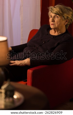 Portrait of senior woman being in mourning - stock photo