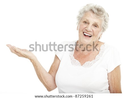 portrait of senior woman gesturing offer with hand over white background - stock photo