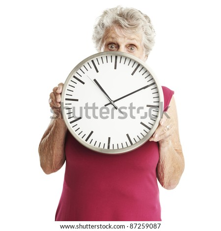 portrait of senior woman holding clock over white background