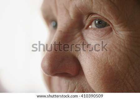 portrait of senior woman in living room, shallow focus photo - stock photo