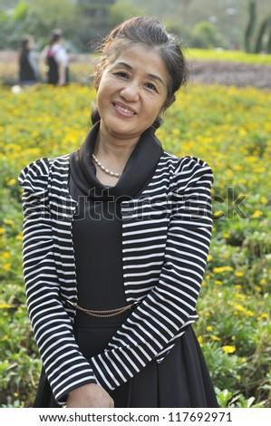 Portrait Of Senior Woman In Park - stock photo