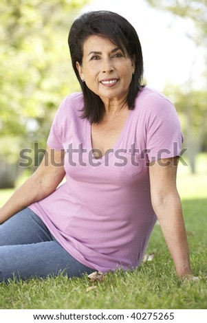 Portrait Of Senior Woman In Park - stock photo