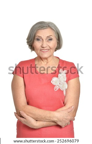 Portrait of senior woman in red dress on white background - stock photo