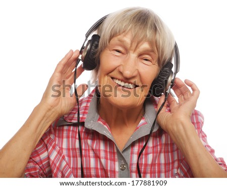 portrait of senior woman listening to music isolated on white