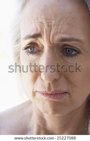 Portrait Of Senior Woman Looking Anxious - stock photo