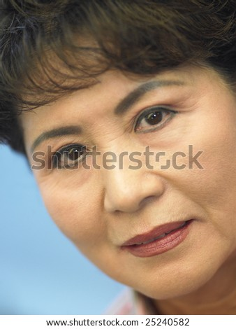 Portrait Of Senior Woman Looking At The Camera - stock photo