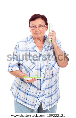 Portrait of senior woman on the phone, isolated on white background. - stock photo