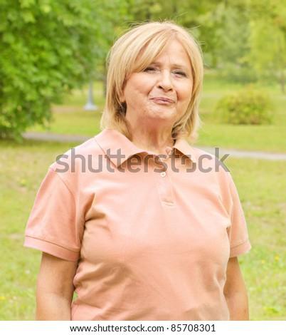 Portrait of senior woman outdoors. - stock photo