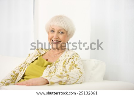 Portrait of senior woman sitting on couch