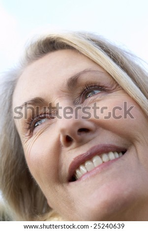 Portrait Of Senior Woman Smiling - stock photo
