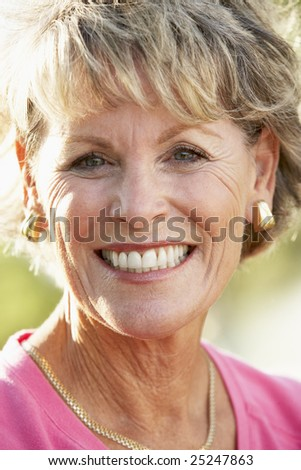 Portrait Of Senior Woman Smiling At The Camera - stock photo
