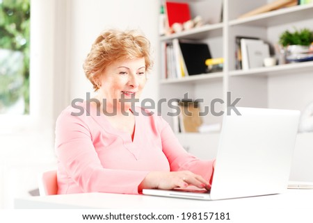 Portrait of senior woman surfing on internet.  - stock photo