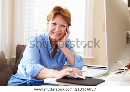 Portrait Of Senior Woman Using Computer At Home - stock photo