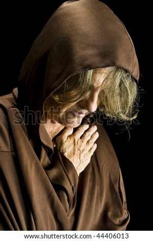 Portrait of Senior woman with a brown cloth . - stock photo