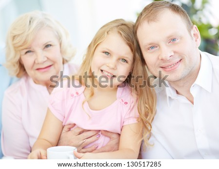 Portrait of senior woman with her granddaughter and son