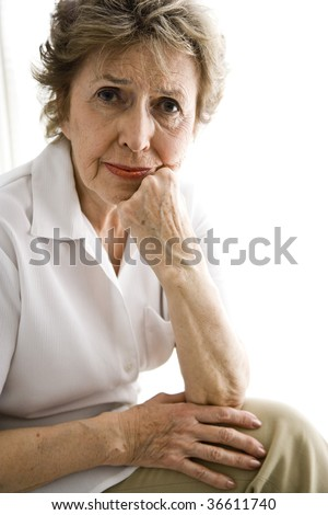 Portrait of senior woman with serious expression - stock photo