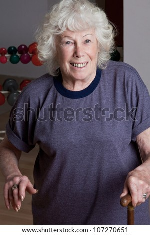 Portrait of senior woman with walking stick. - stock photo