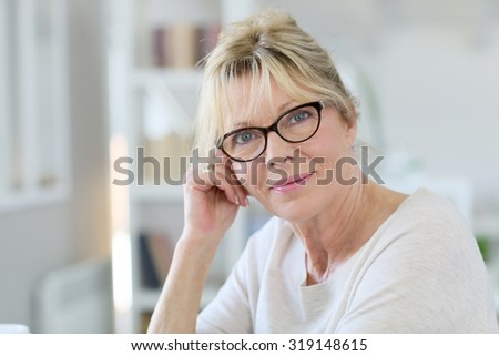 Portrait of senior woman working on laptop computer - stock photo