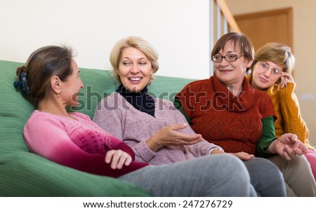 Portrait of senior women having discussion indoor and laughing