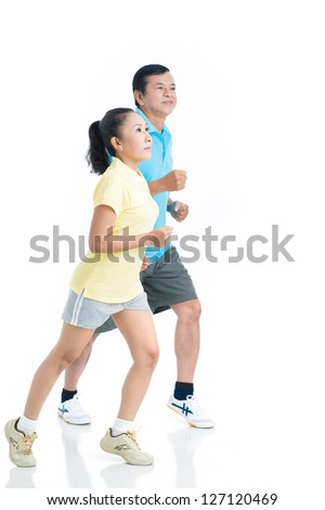 Portrait of seniors in sportswear running - stock photo