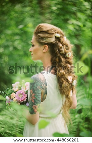portrait of sensual attractive tattoo bride
