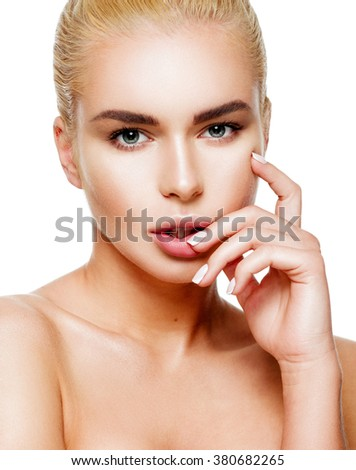 Portrait of sensual beautiful young blonde woman touching face, isolated over white background. Skin care concept. Portrait of beautiful young blonde girl with clean skin. Looking at camera. - stock photo