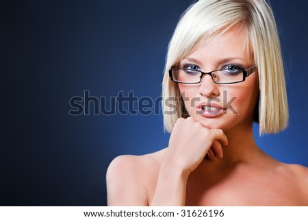 Portrait of sensual Caucasian teacher with glasses.