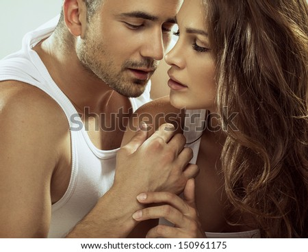 Portrait of sensual couple - stock photo