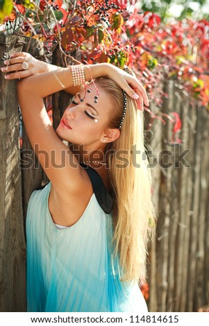 Portrait of sensual girl dreaming in red foliage