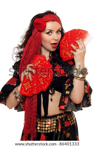 Portrait of sensual gypsy woman with cards. Isolated - stock photo