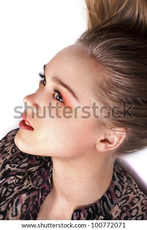 portrait of sensual pretty woman posing while lying on floor, close up - stock photo