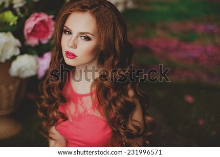 Portrait of sensual redhead young girl on floral background - stock photo