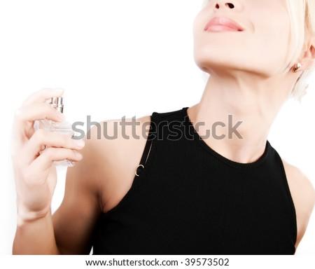 Portrait of sensual woman applying perfume on her body - stock photo