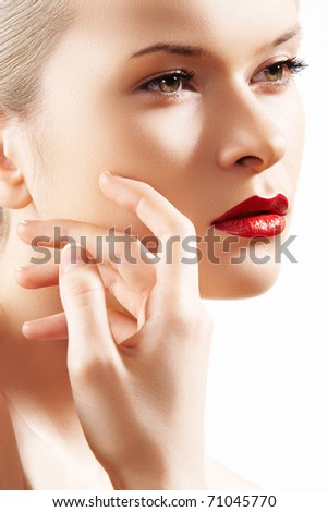 Portrait of sensual woman model with fashion bright red lips make-up, clean healthy skin